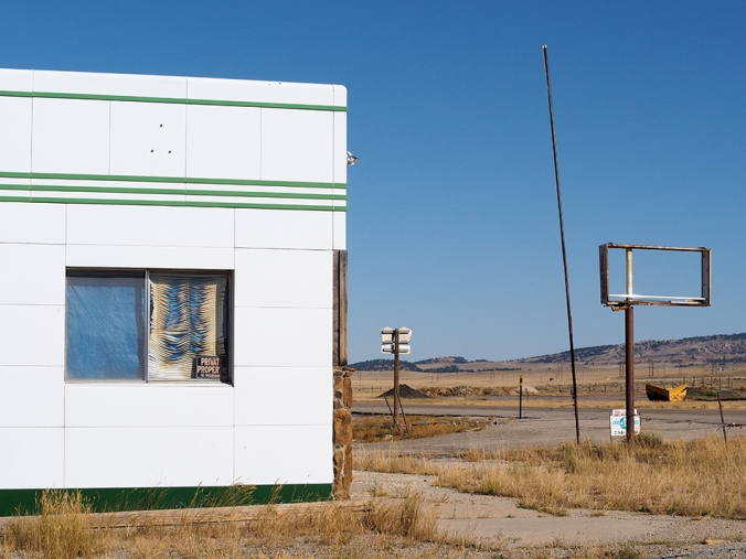 Abandoned gas station, Powder River, Wyoming