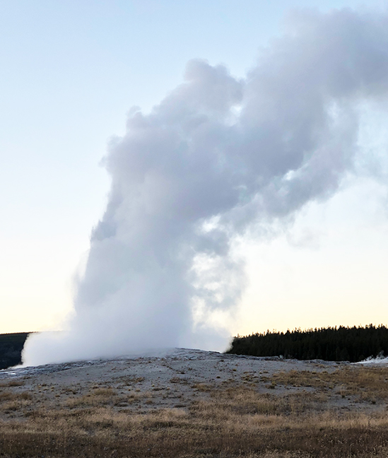 Old Faithful at dusk